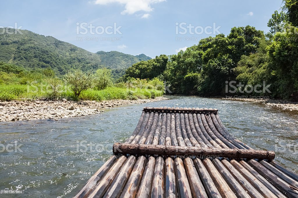 bamboo raft in the stream stock photo