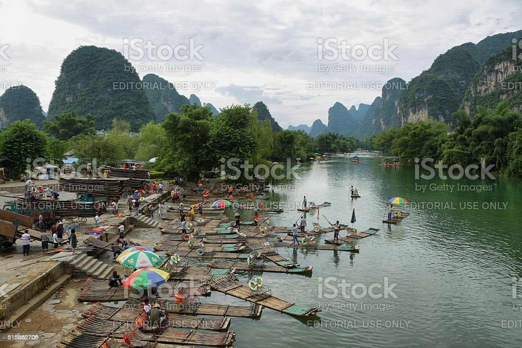 Bamboo rafts and karst mountains reflected in Yulong river stock photo