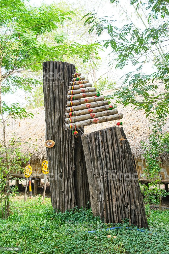 bamboo rainstick filled stock photo