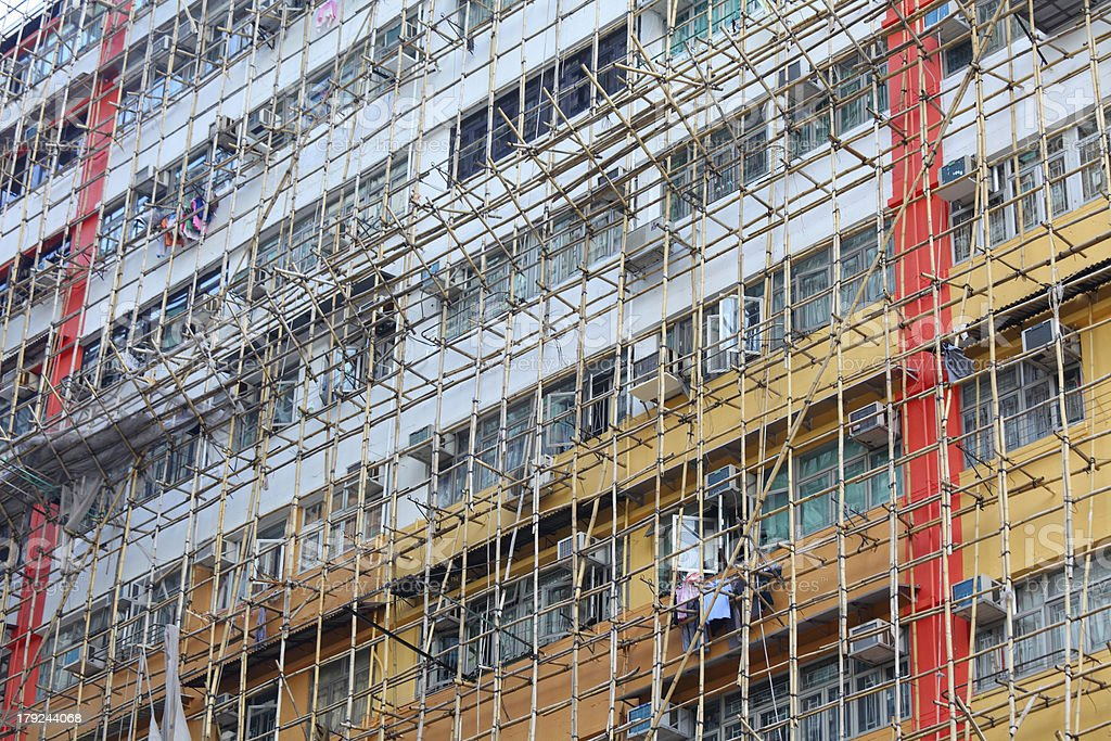 Bamboo scaffolding of repairing old building stock photo