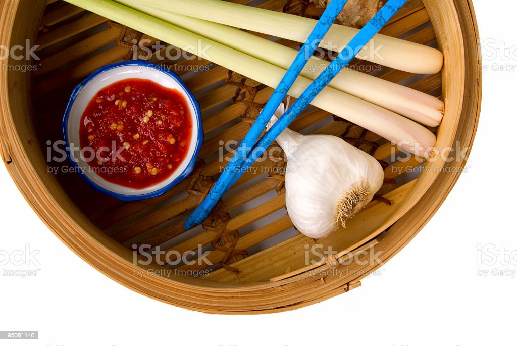 Bamboo steamer with Asian cooking ingredients stock photo
