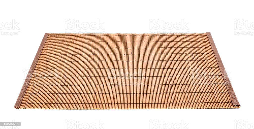 Bamboo straw serving mat isolated stock photo