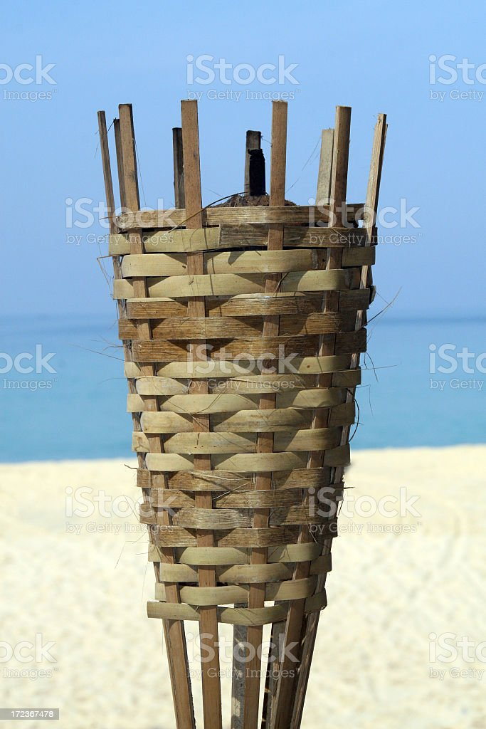 Bamboo Torch Lights At The Beach stock photo
