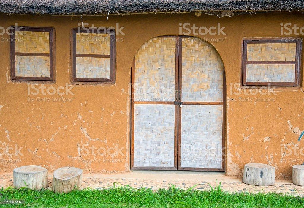 Bamboo wickerwork window and door of a vintage cob house stock photo