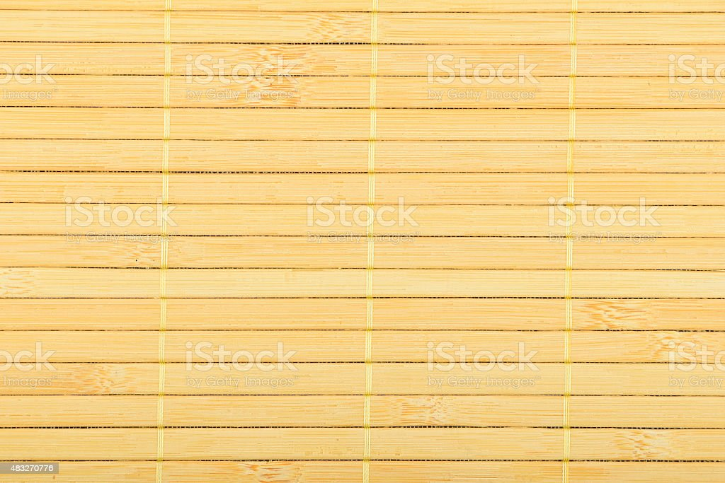 Bamboo wooden light yellow wicker braided mat background royalty-free stock photo