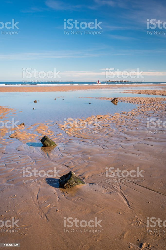 Bamburgh Beach Shipwreck in portrait stock photo