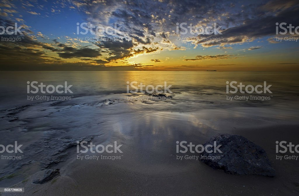 Bamburgh beach sunrise stock photo