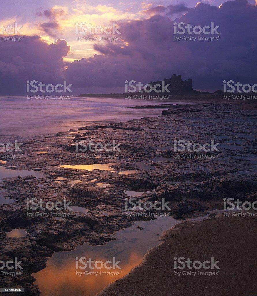 Bamburgh Castle and beach, Northumberland, at dawn royalty-free stock photo