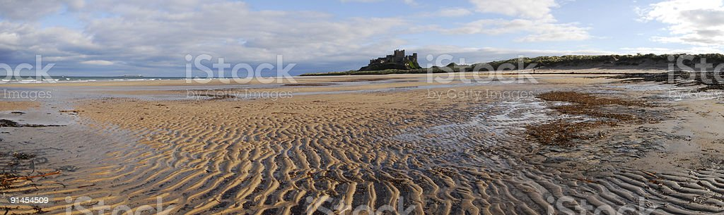Bamburgh Castle and Beach royalty-free stock photo