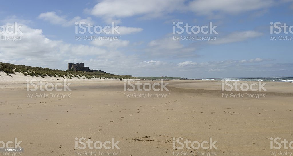Bamburgh Castle and deserted beach stock photo