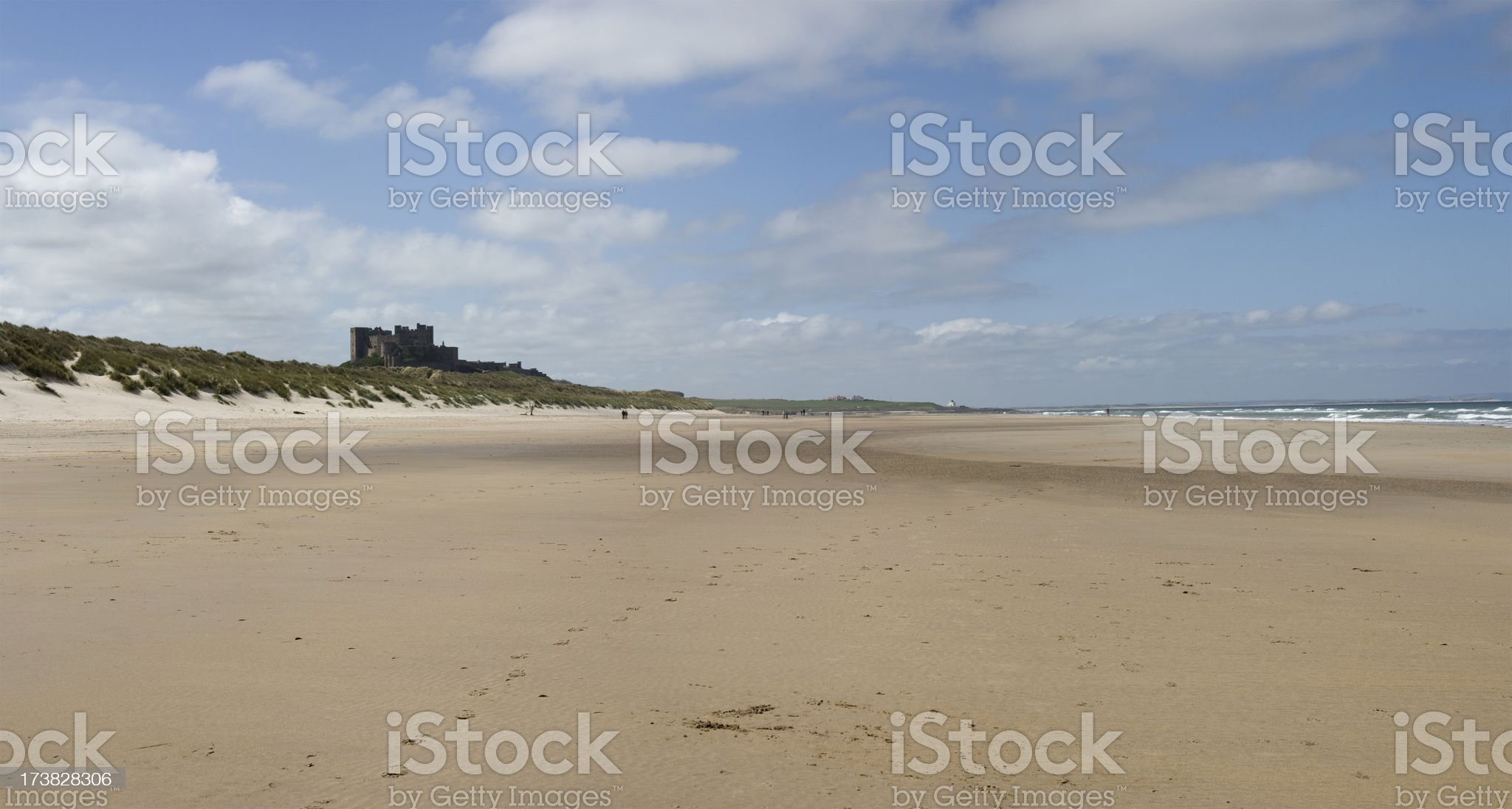 Bamburgh Castle and deserted beach royalty-free stock photo