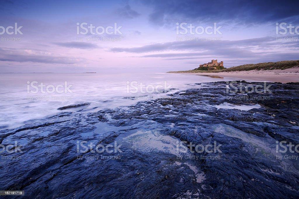 Bamburgh Castle at Sunset stock photo