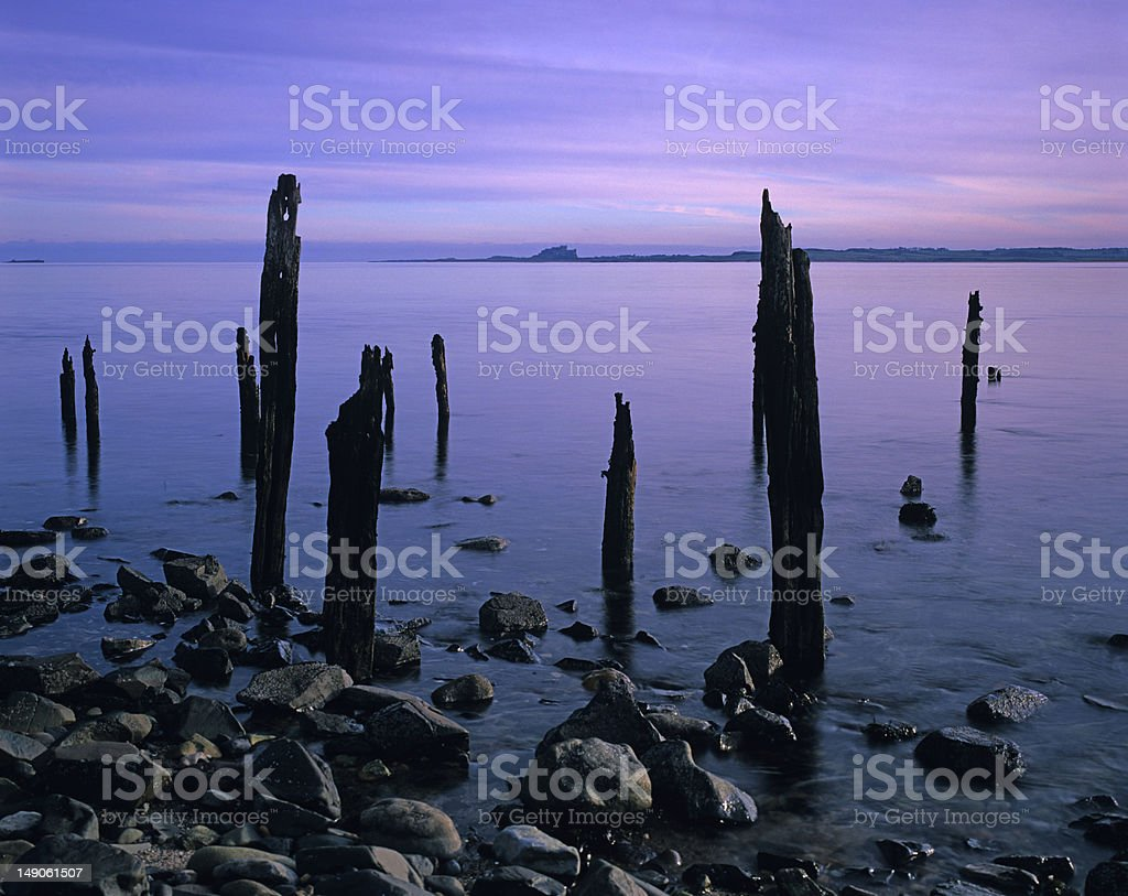 Bamburgh Castle from Lindisfarne jetty royalty-free stock photo
