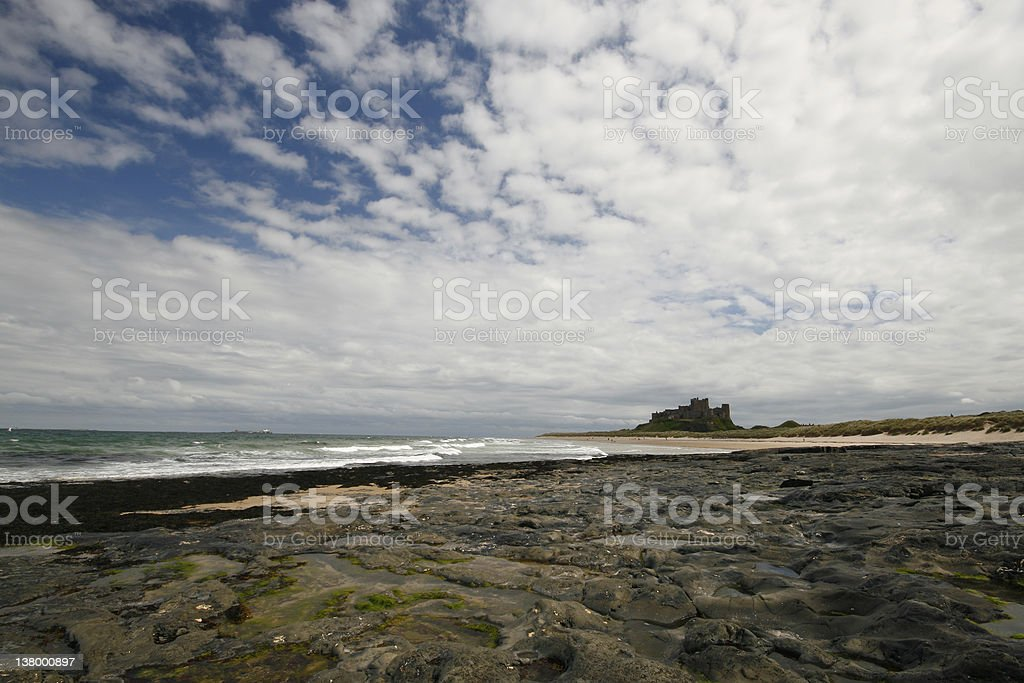Bamburgh Castle with Rocky Foreground royalty-free stock photo