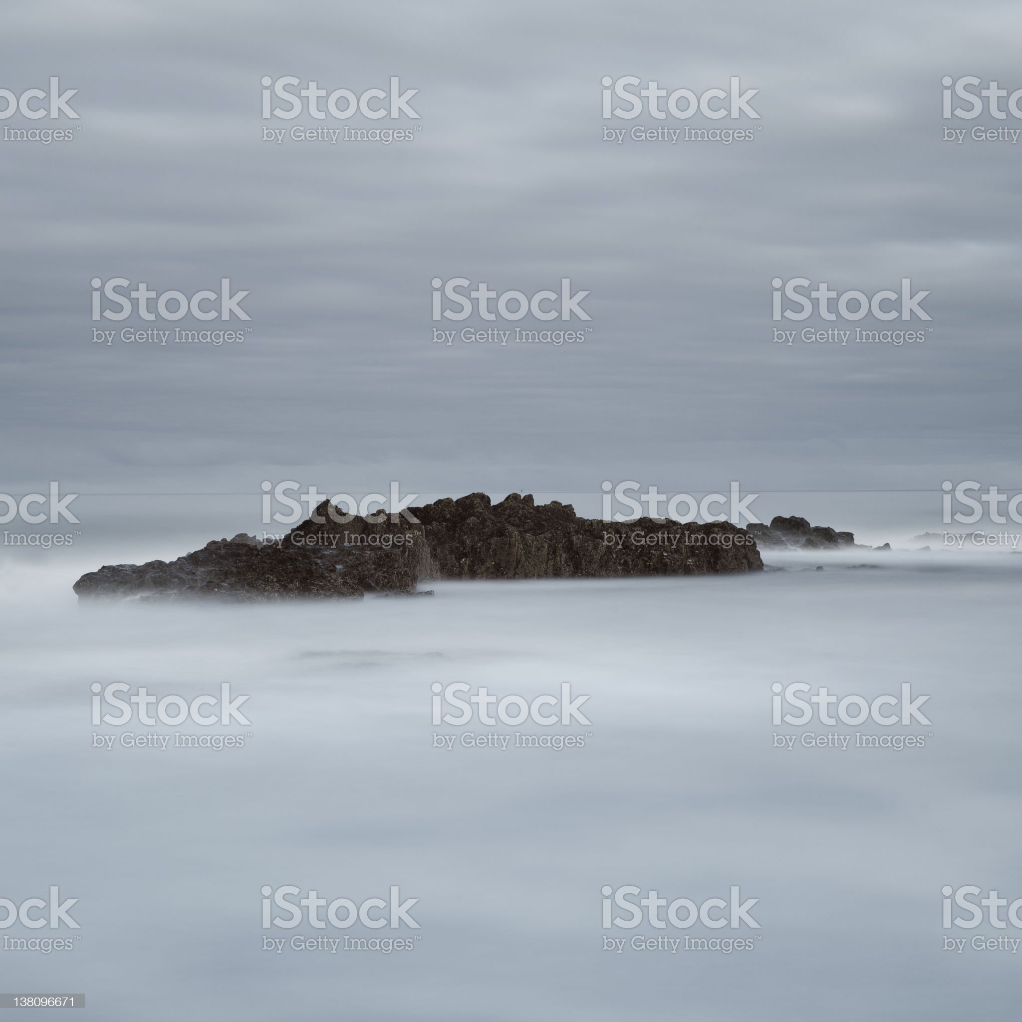 Bamburgh rocks in long exposure royalty-free stock photo