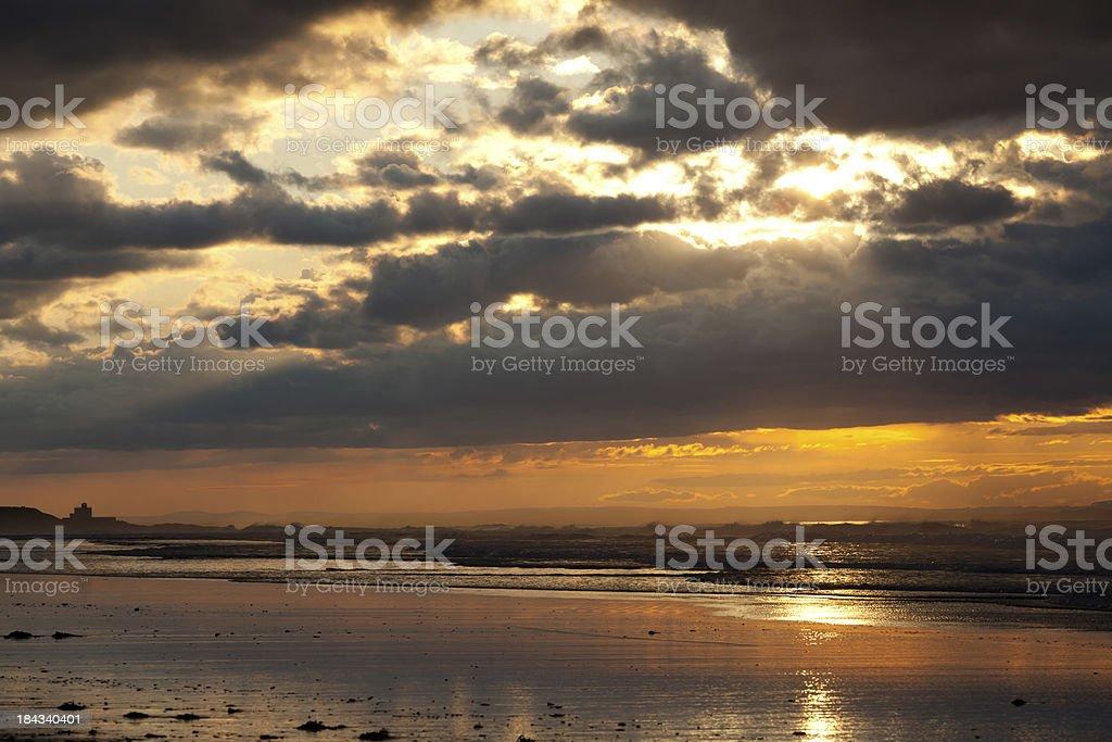 Bamburgh sunset Northumberland royalty-free stock photo