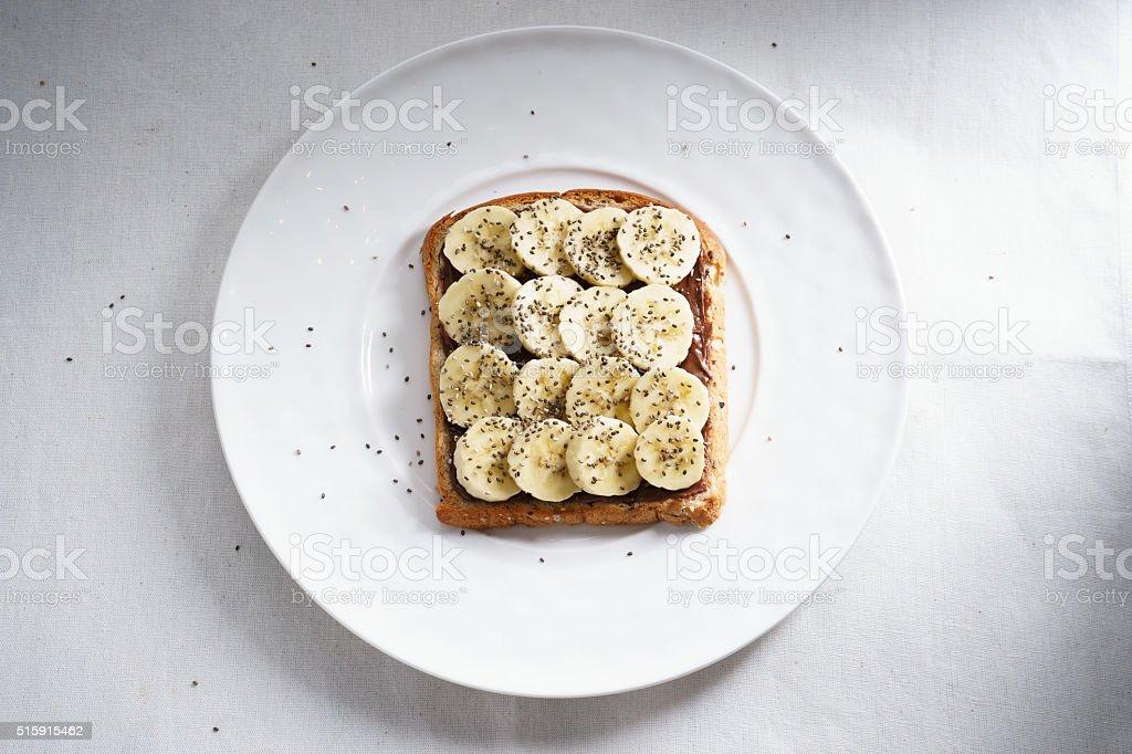banana and chia seeds toast stock photo