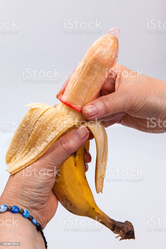 Banana and condom stock photo