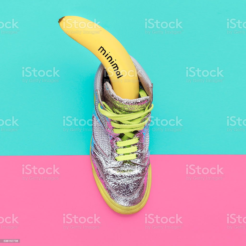 Banana and glamorous sneakers. Minimalism fashion stock photo