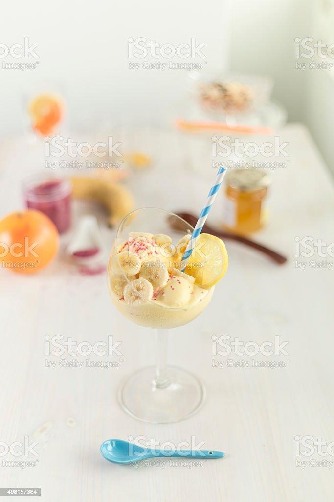 banana and lemon and vanilla flavour milkshake and sprinkles stock photo