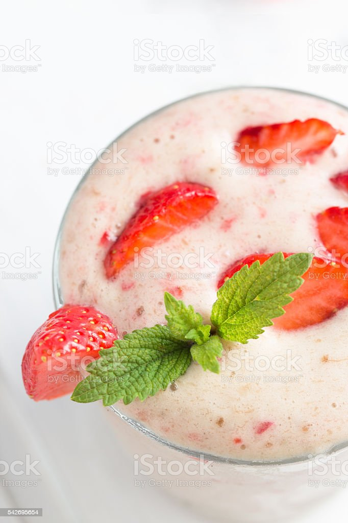 Banana and strawberry smoothie on white background royalty-free stock photo