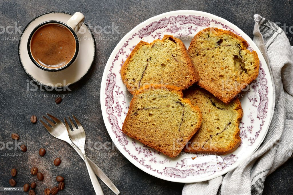 Banana cake with cup of coffee stock photo