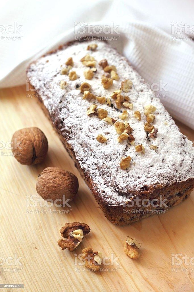 Banana cake with walnuts and dark chocolate stock photo