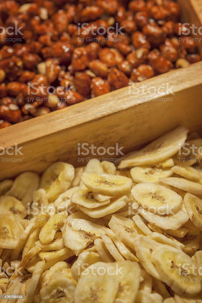 Banana chips and peanuts on market royalty-free stock photo