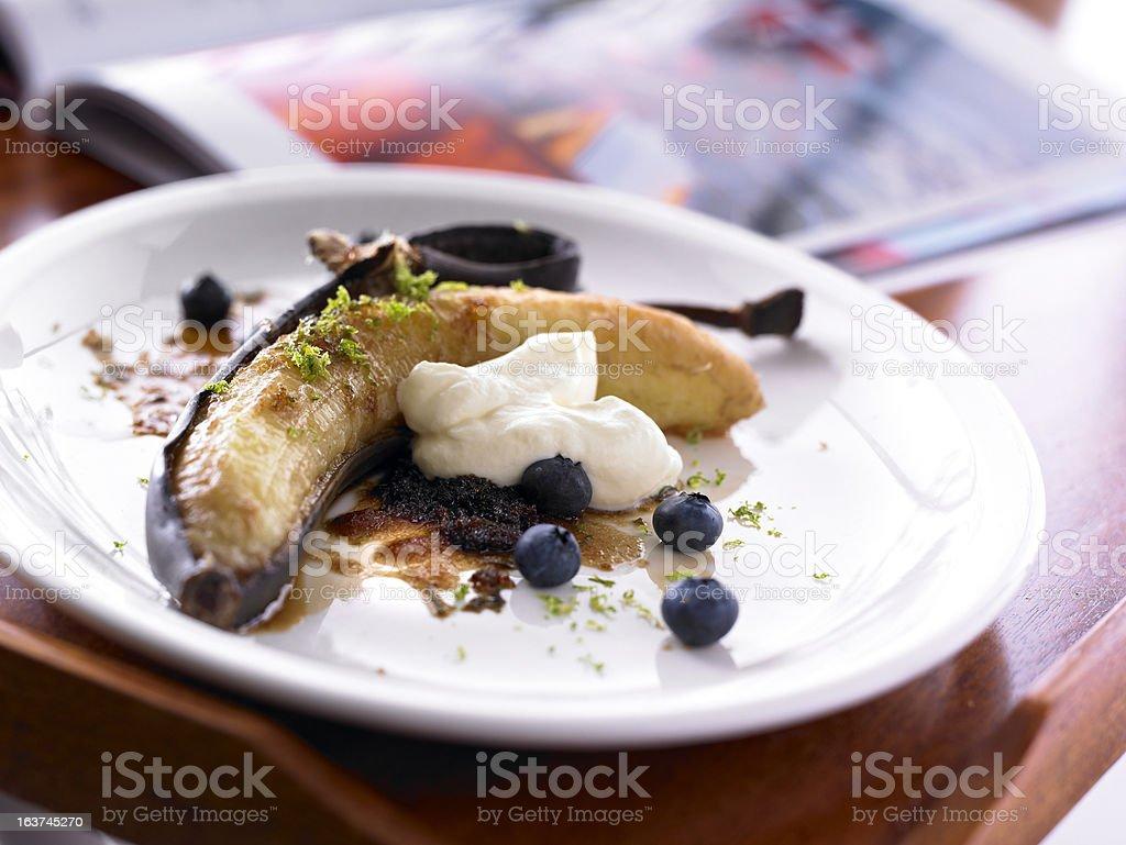 Banana dessert peel blueberries whipped cream white Plate stock photo