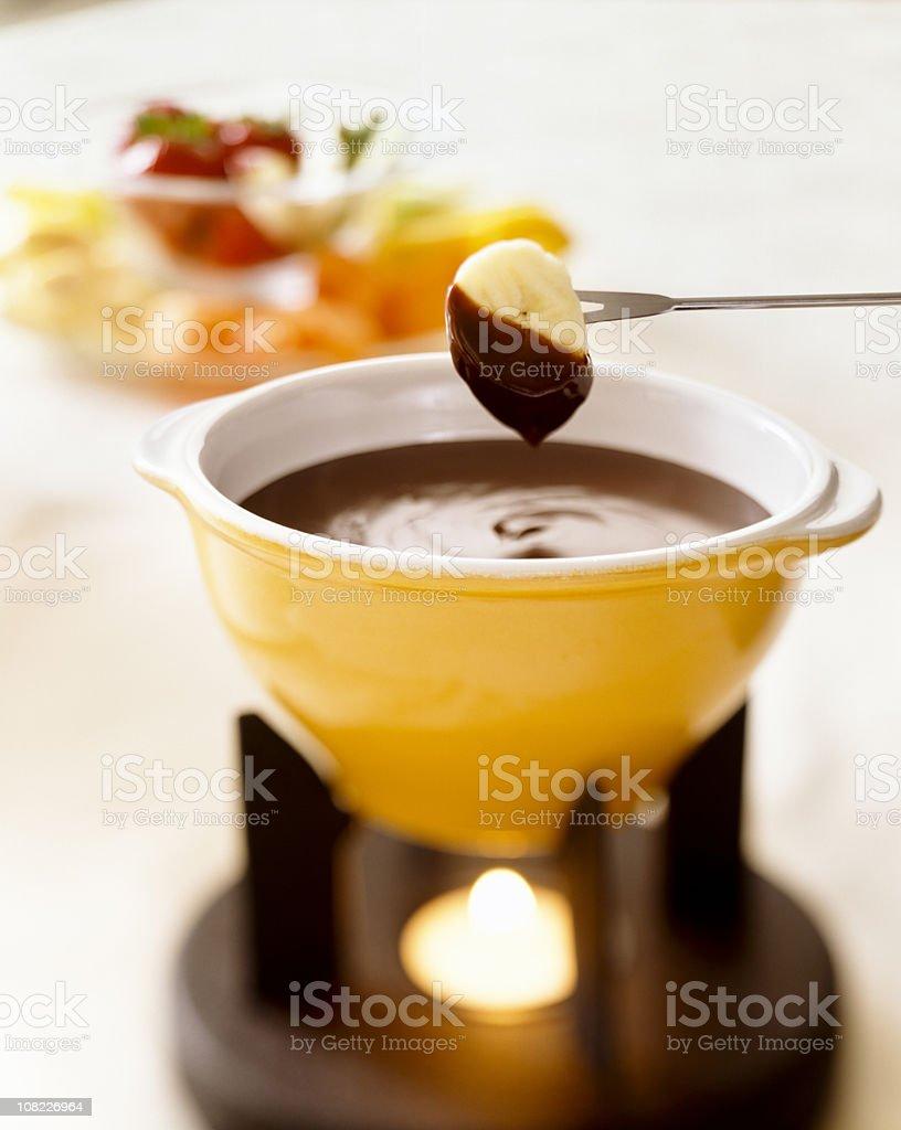 Banana Dipped in Chocolate Fondue stock photo