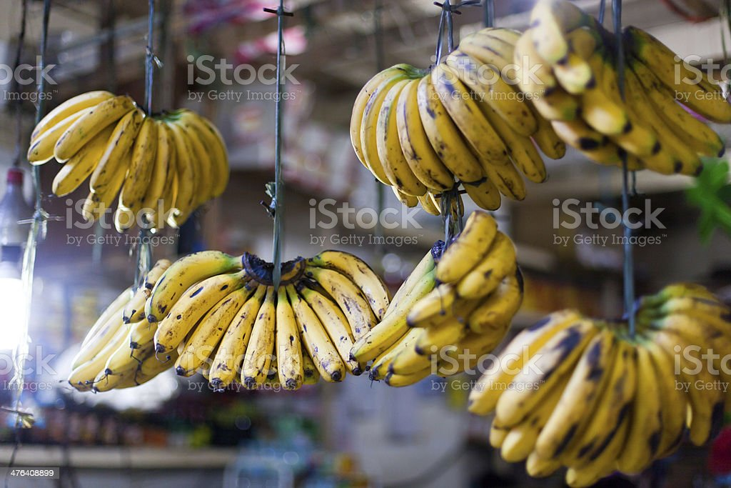 Banana hanging in asian market royalty-free stock photo