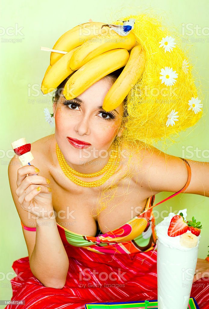 Banana lady with a cream strawberry cocktail royalty-free stock photo