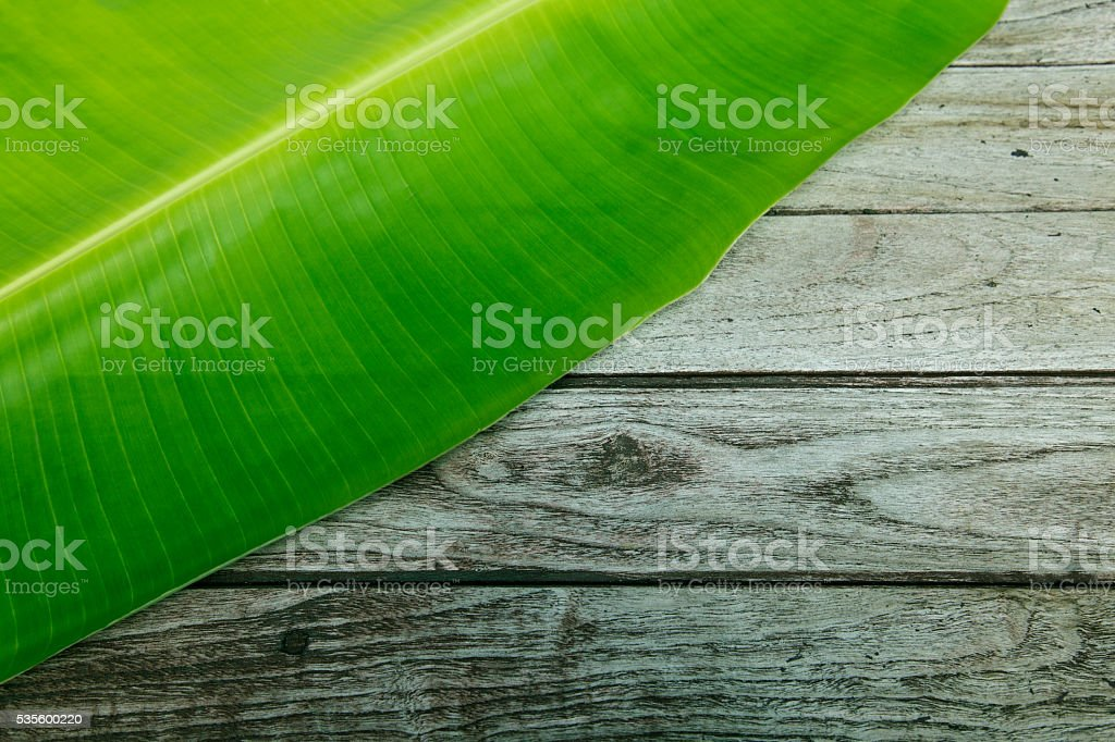 Banana leaves on wooden background royalty-free stock photo
