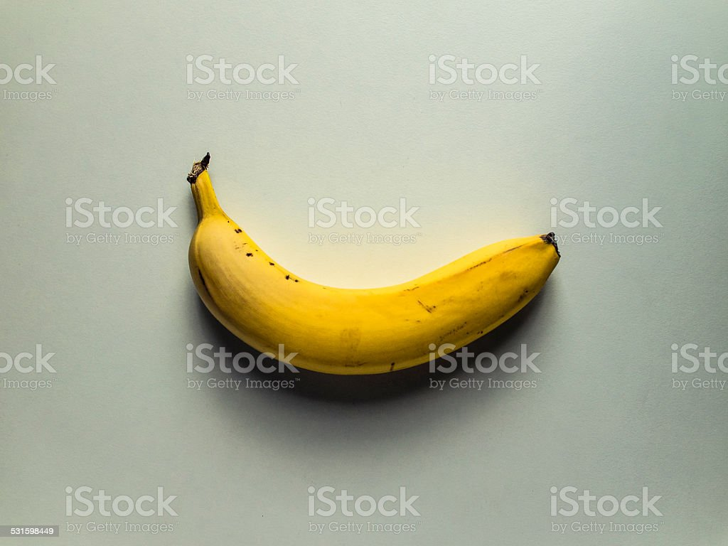 Banana lying on white table stock photo