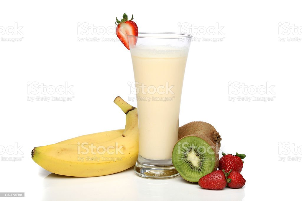 Banana milkshake with fruit composition stock photo