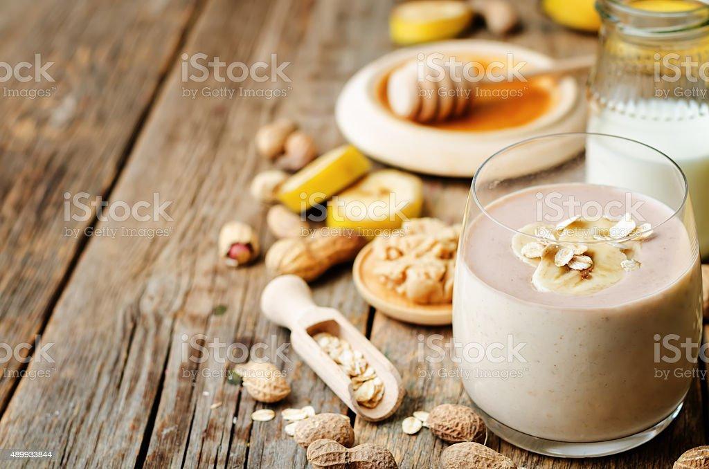 banana oat peanut butter smoothies stock photo