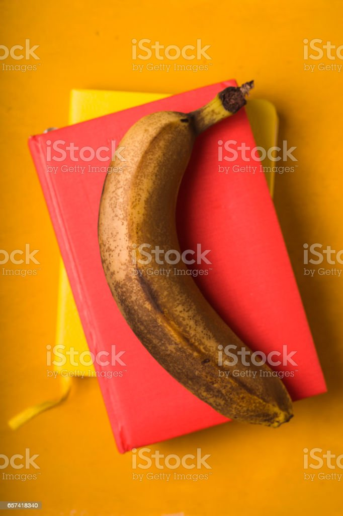 Banana on the colorful background top view stock photo