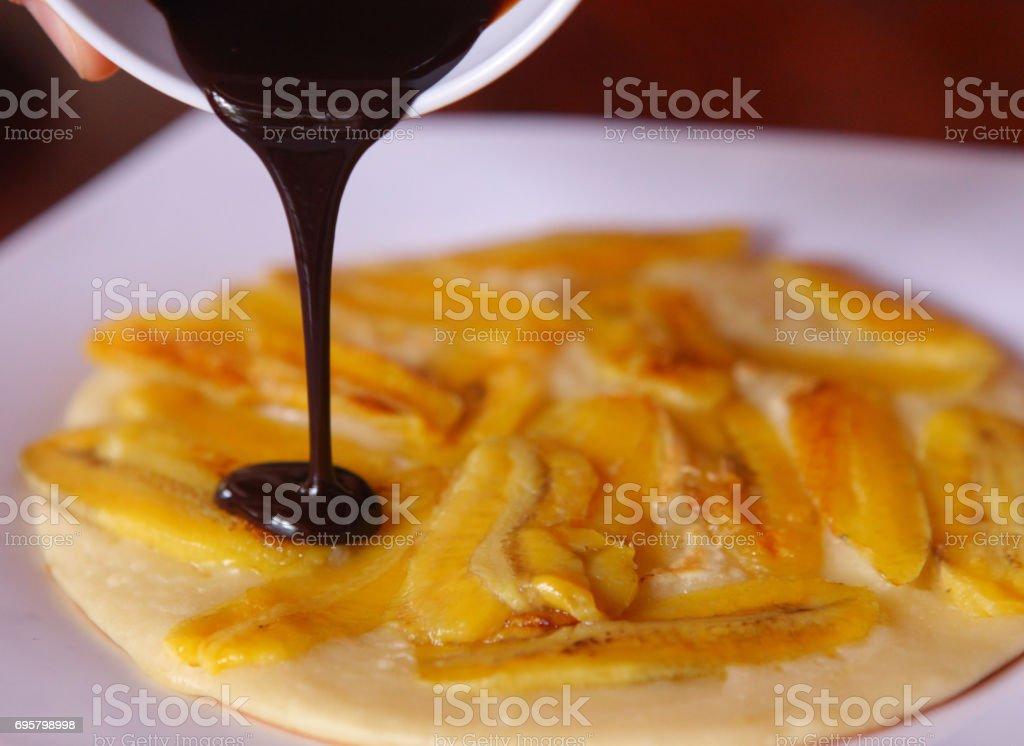 banana pancake with chocolate sauce stock photo