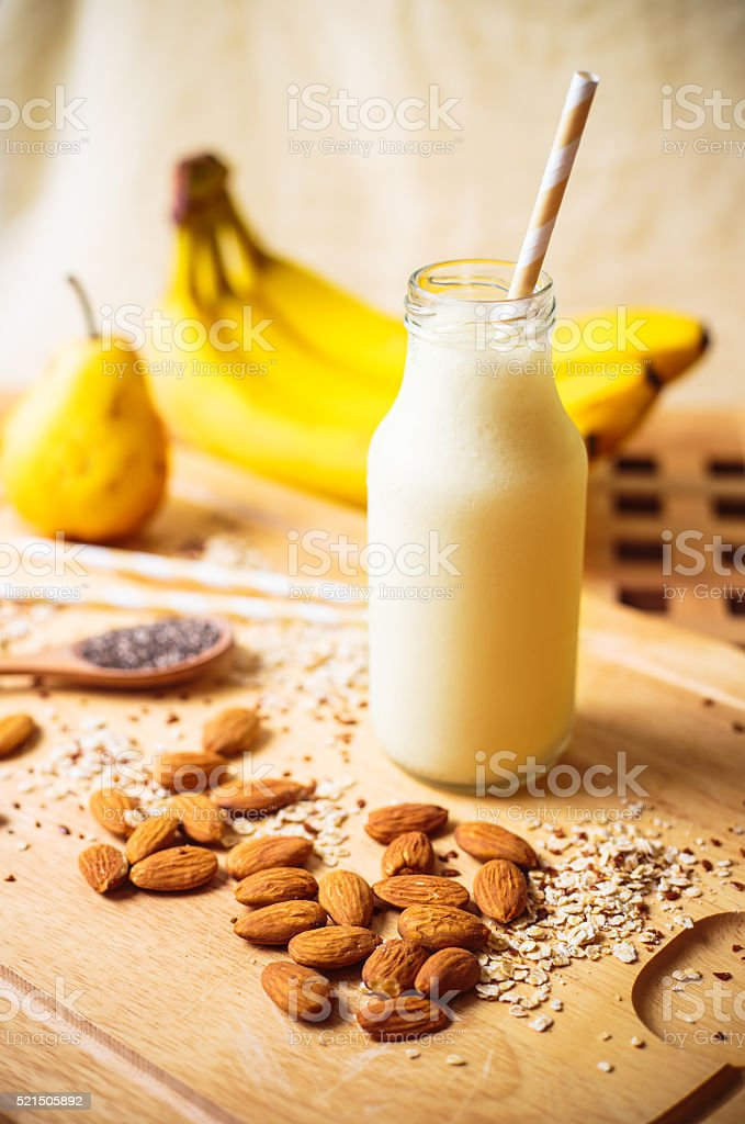 Banana pear almonds smoothie stock photo