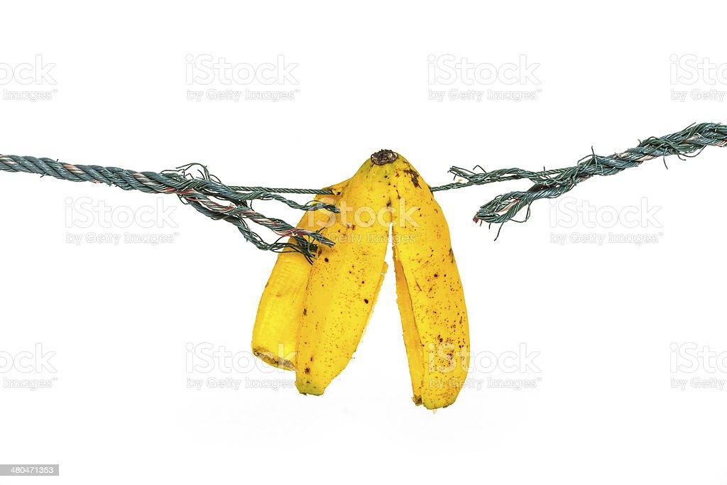 Banana peel on the ropes stock photo