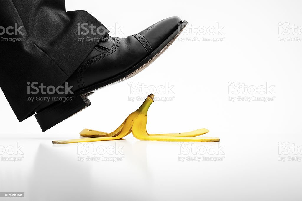 Banana peel slip - Shoe Risk Accident Falling Concept Photography stock photo