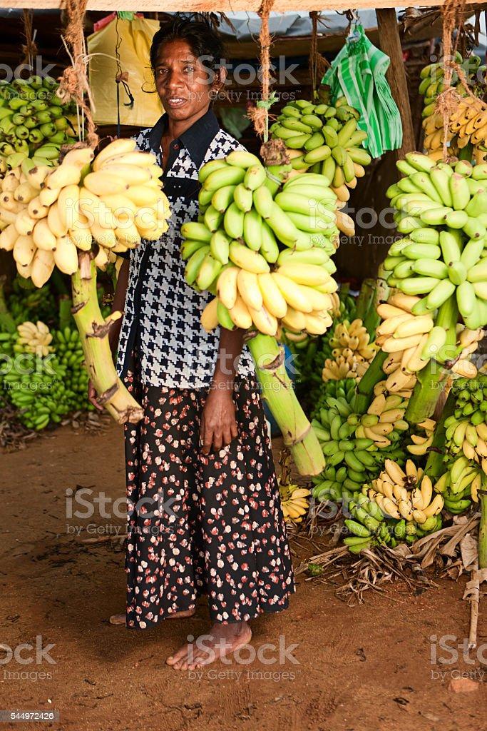 Banana seller in his shop. Sri Lanka stock photo