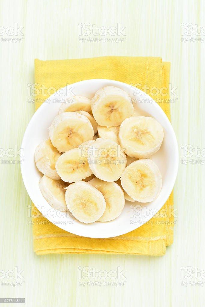 Banana slices in bowl stock photo