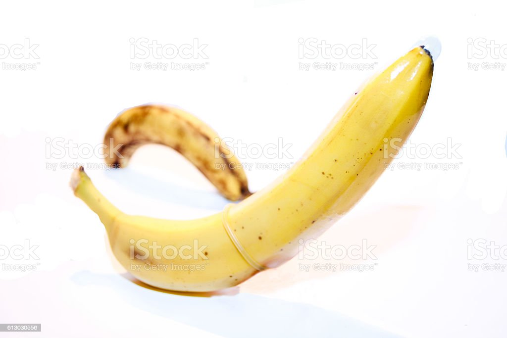 Banana with a condom. stock photo