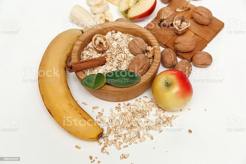 Banana,Apple,Walnuts,Wooden Plate and Rolled Oats,Healthy Food stock photo