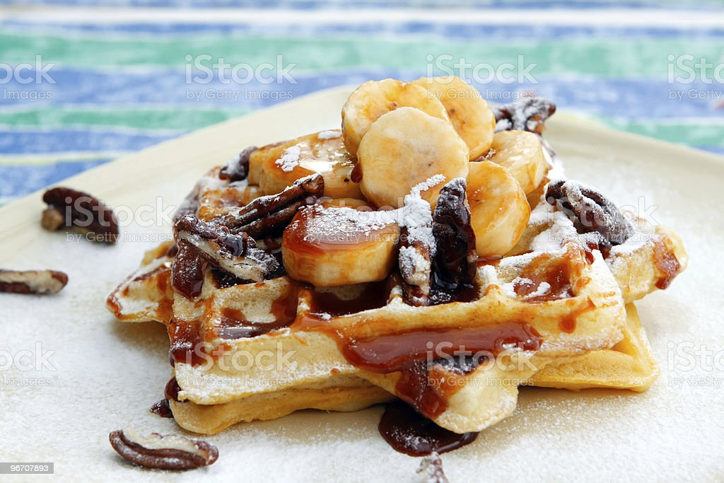 Banana-Pecan and caramel waffles stock photo