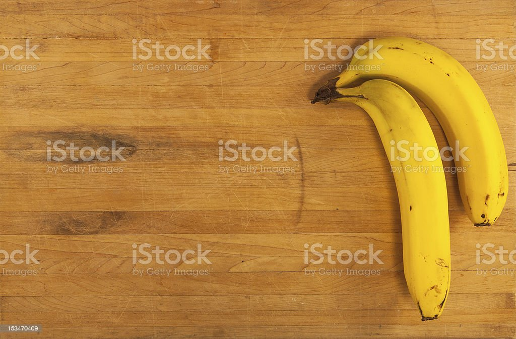 Bananas on Butcher Block royalty-free stock photo
