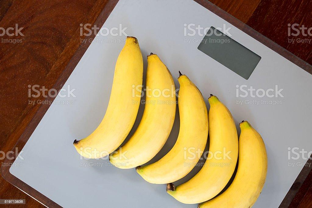 bananas on weighing machine stock photo