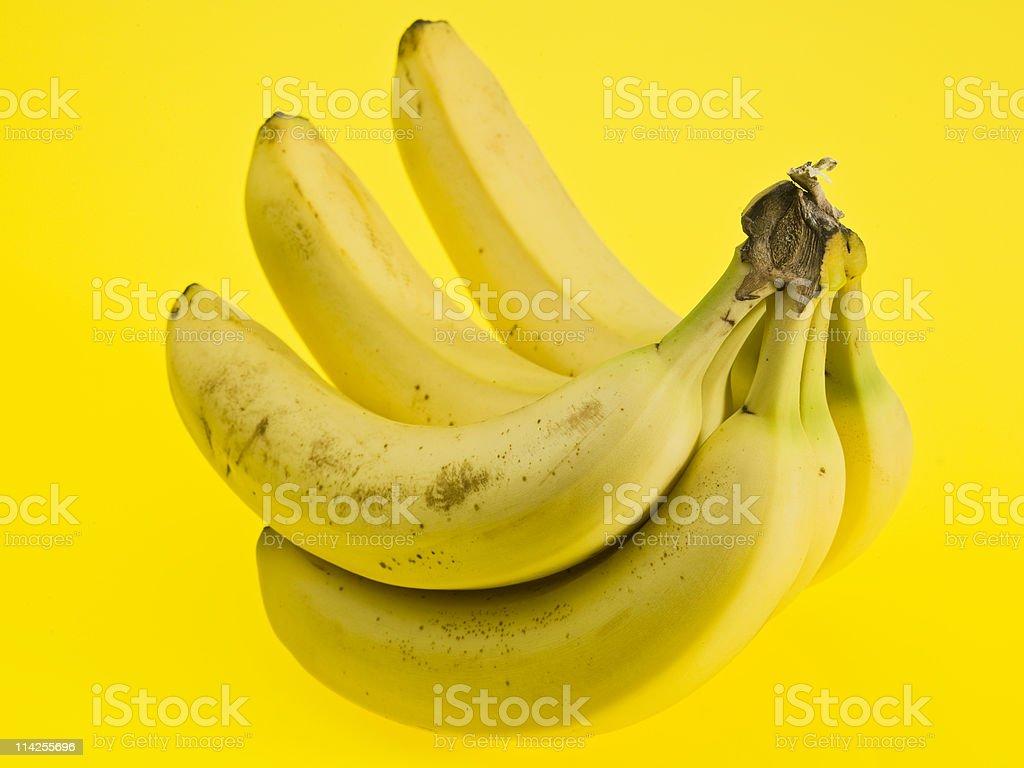Bananas on Yellow royalty-free stock photo