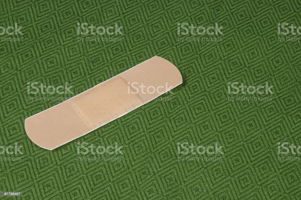 Band aid on Green stock photo
